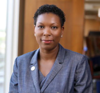 Image of an African American woman wearing a blue blazer