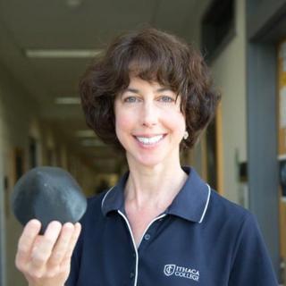 Home ithaca college professor beth ellen clark holds a model of the asteroid bennu fandeluxe Images