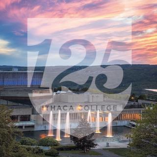 """125"" icon overlayed over scenic view of fountains at sunset."