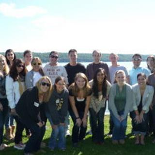 Members of the dean's advisory council posed in front of a lakeview