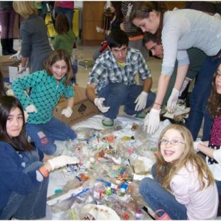 College students with elementary school students, learning about recyling