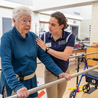 This is a picture of an elderly woman receiving physical therapy services from a student in our clinic.