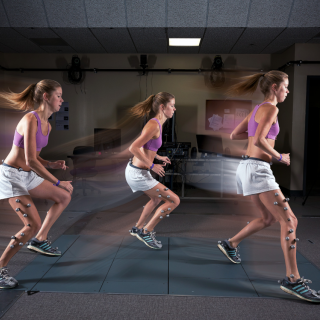 This is a progressive image of the same student in pink top and white shorts running from left to right in our Movement Analysis Lab.
