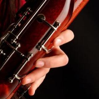 Closeup of fingers on a bassoon.