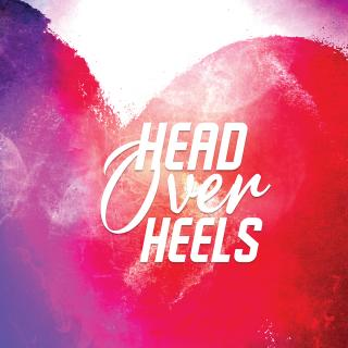 "Musical title, ""Head Over Heels"" against background of purple and red heart."