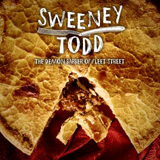 "Play title ""Sweeney Todd"" against background of a pie"