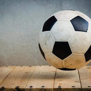Soccerball on wood floor.